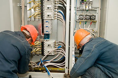Electricians working on a commerical circuitboard