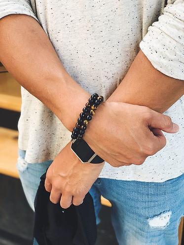 Close up of Man wearing men's bracelets