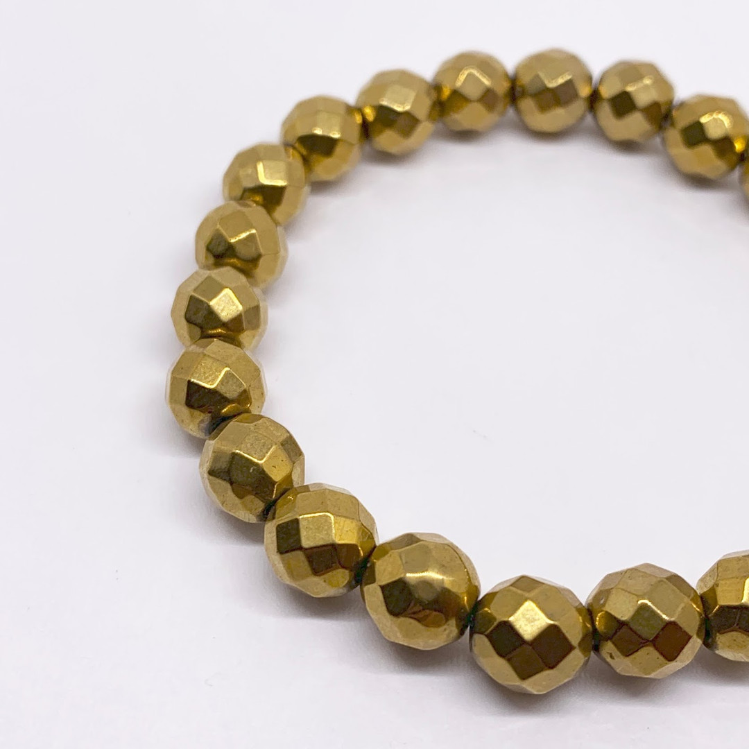 Faceted Gold Titanium Hematite