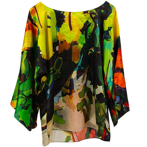 front of silk blouse made in italy with red, yellow, green black, and white