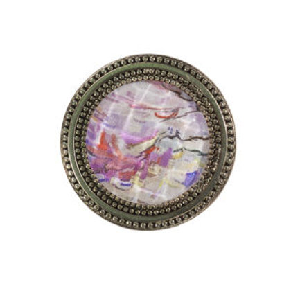 magnetic scarf pin painted with pink floral imagery of a cherry treeunder a faceted crystal made in the use