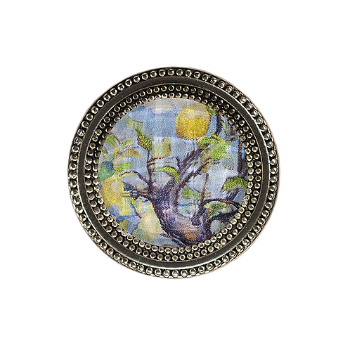 golden magnetic scarf pin with painting of  lemon tree under a faceted crystal
