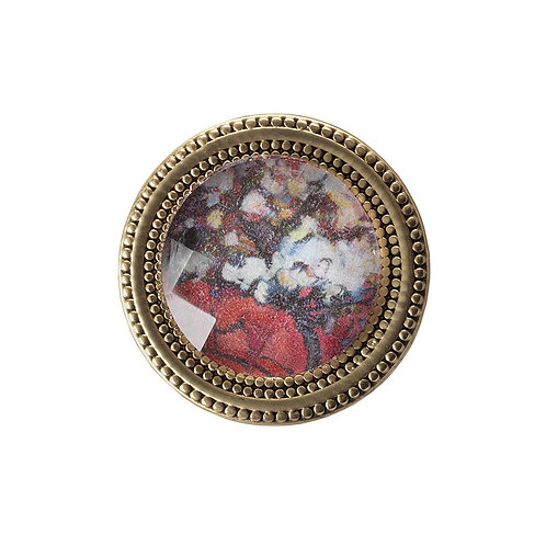 golden magnetic pin with pink floral imagery
