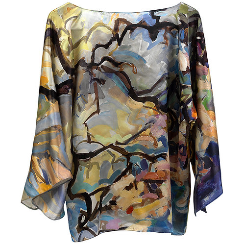 front of silk blouse made in italy with gray, blue, yellow, pink, white, black hanging