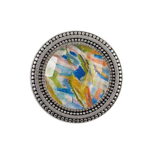 magnetic pin with painted floral imagery under a faceted crystal