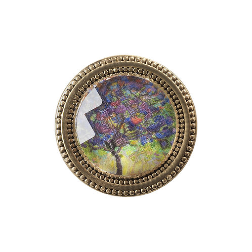 magnetic scarf pin with purple and yellow floral imagery under a faceted crystal