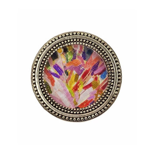 round magnetic scarf pin painted with impressionistic brushstrokes under a faceted crystal made in the use
