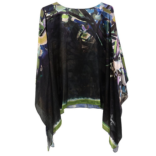 front of silk poncho made in italy named eden with painted imagery of a cherry tree