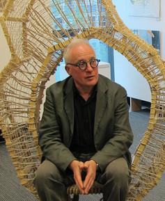 ted sitting in sculpture.jpg
