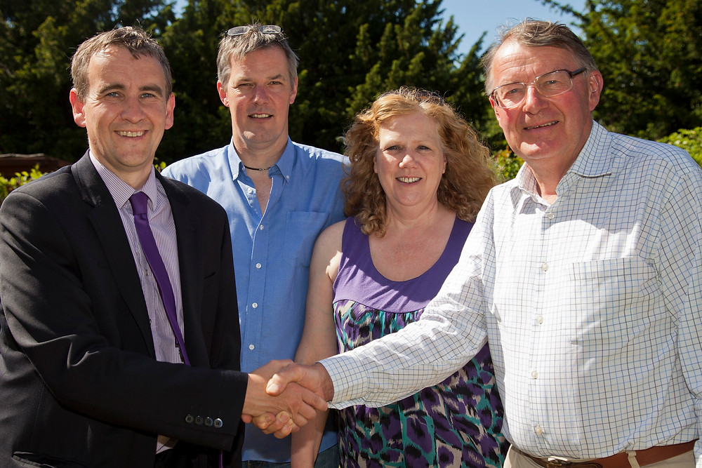 From left to right: Allister Page (current Chairman), Dave Gasparini (current Manager), Liz Johnston (first Manager) and Michael Williams MBE (first Chairman).