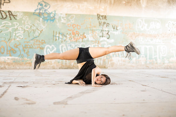 bigstock-Female-Dancer-Doing-A-Leg-Spli-