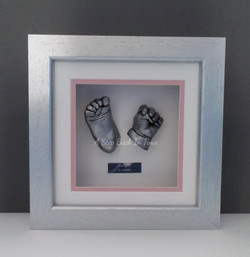 Baby hand and foot cast in silver frame
