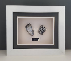 Framed 3D baby casts of hand and foot