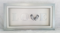 Love frame with 3D silver baby feet