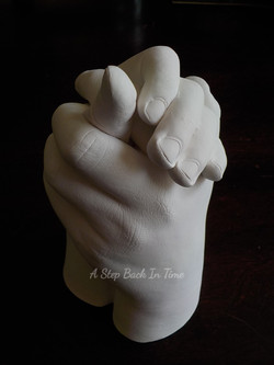 3D sibling hand clasp