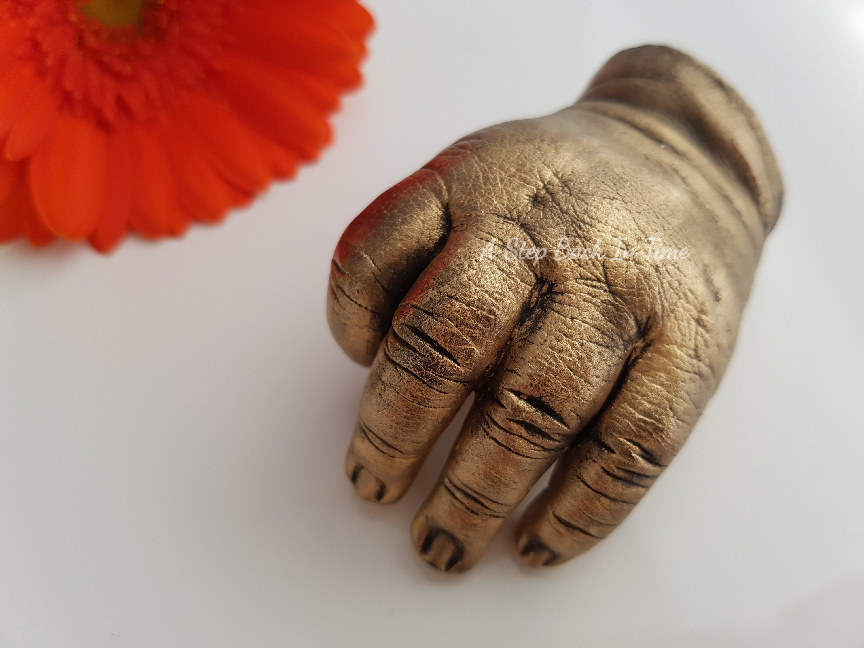 3D cast of baby hand in gold
