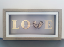 Love frame with 3D baby feet