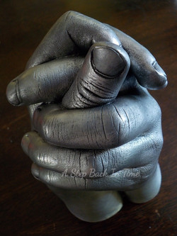 Sibling hand clasp cast