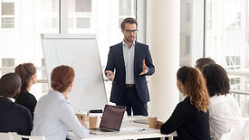 Male business coach speaker in suit give