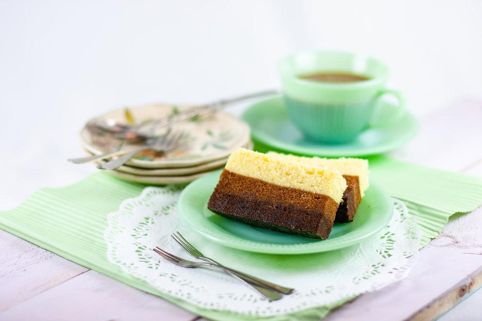 Bolu Kukus Trio or tri-layers steamed cake  consisting of chocolate, mocha and vanilla lay