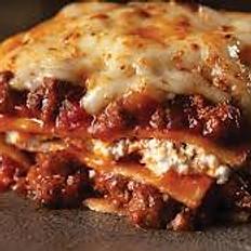 Beef lasagna served with garden salad and balsamic vinagrette