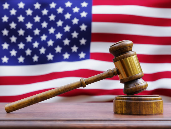 gavel-in-front-of-american-flag-PFESRZU.