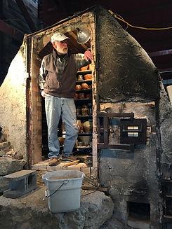 Gary Carstens unloading the wood kiln.