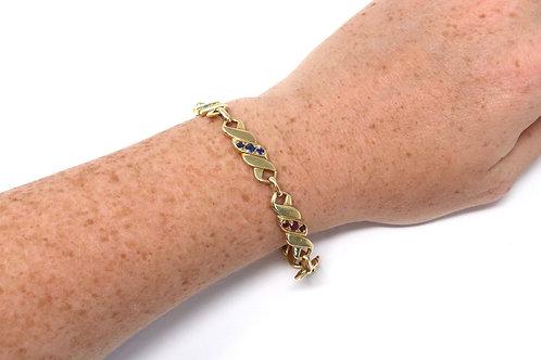 A Vintage C1960's 18ct Gold M Gerard Ruby Diamond Sapphire Emerald Curb Bracelet