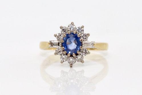 A Vintage 18ct 0.65ct Cornflower Blue Sapphire & 0.50ct Diamond Cluster Ring