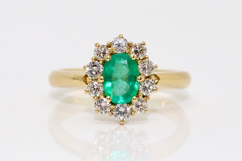 A Modern Contemporary 18ct Gold 0.75ct Emerald & 0.50ct Diamond Cluster Ring