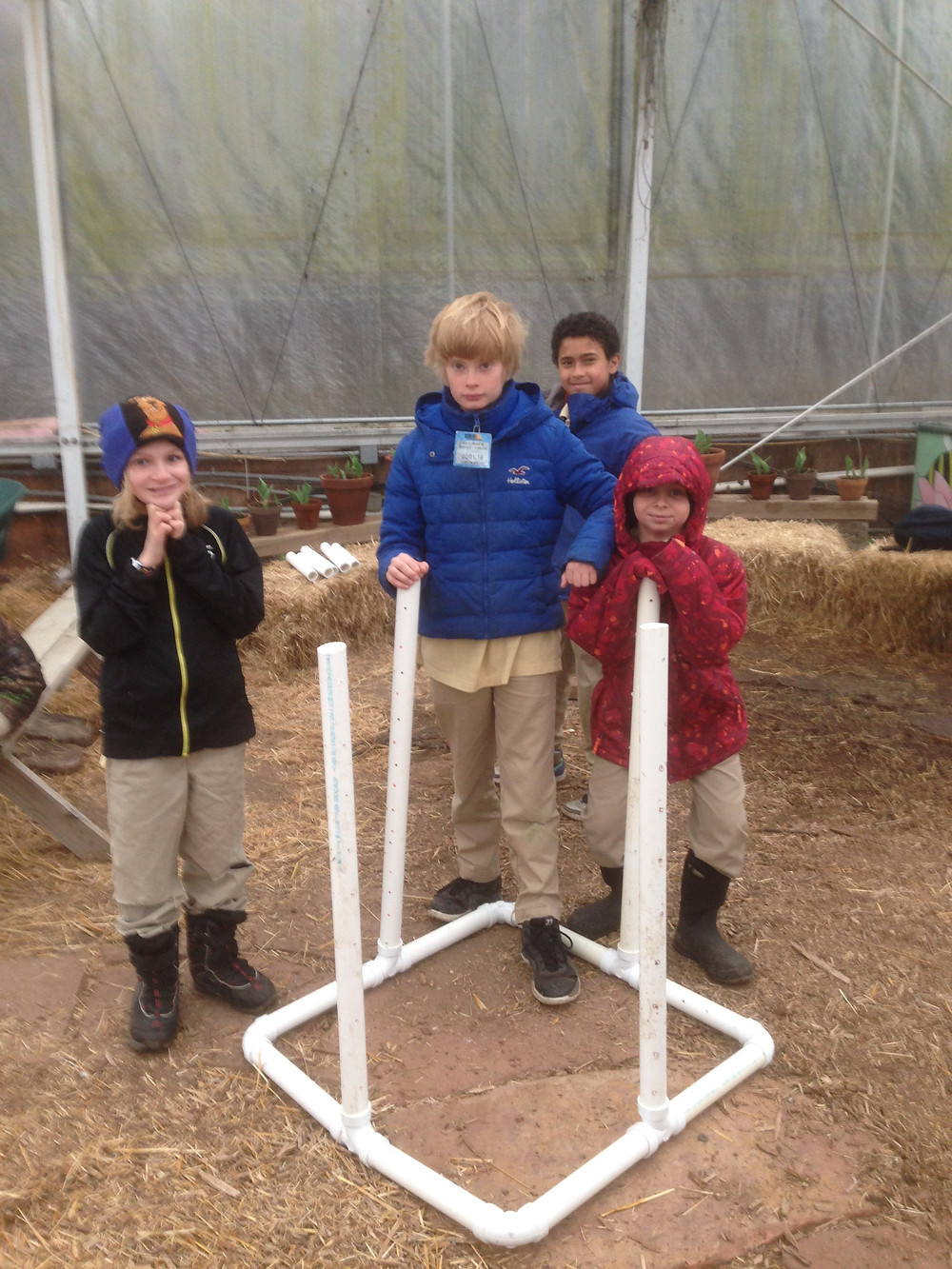 Boys build compost areator