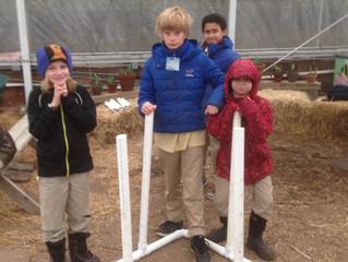 Boys build compost aerator