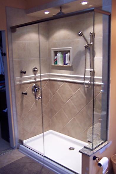 Frameless Glass Shower Enclosure w Header Bar & Channel - Noble Shower Doors
