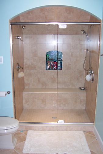 Frameless Glass Enclosure w Header Bar & Pivot Hinges - Noble Shower Doors