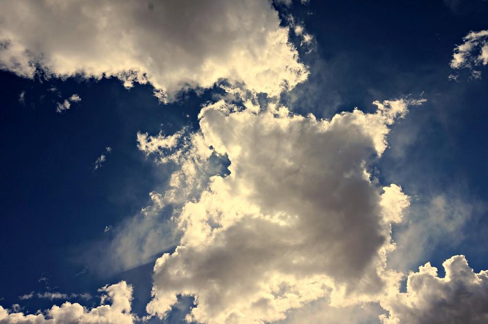 Sun shining through the cloud in the blue sky