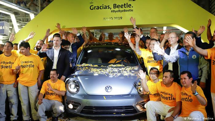 Final VW Beetle driving off Mexico factory floor