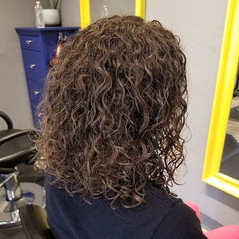 Turned her frizzy dry unruly hair, into