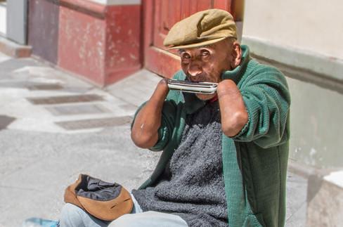 Handless Harmonica Player in Puno