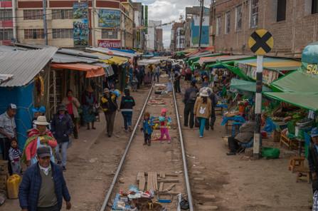 Train through a market