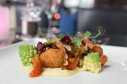 Walnut,_sage_and_artichoke_arancini_served_with_Romanesco_broccoli,_leek_and_potato_purée_and_root_v