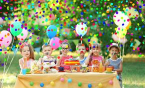 Children celebrating birthday in park.jp