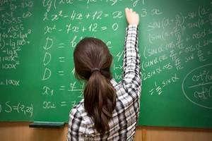 2 Algebra Girl at Chalkboard.jpeg