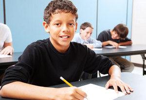 2 Boy in Class Writing.jpeg