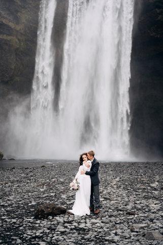 groom-hugs-bride-from-wedding-couple-nea