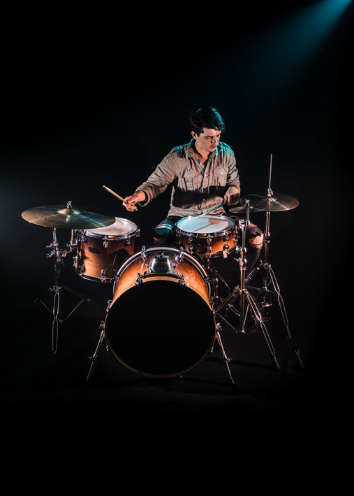musician-playing-drums-black-background-beautiful-soft-light-emotional-play-music-concept.