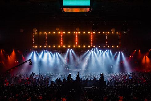 scene-illuminated-by-beautiful-rays-lighting-equipment-concert-crowd-having-fun-center-big