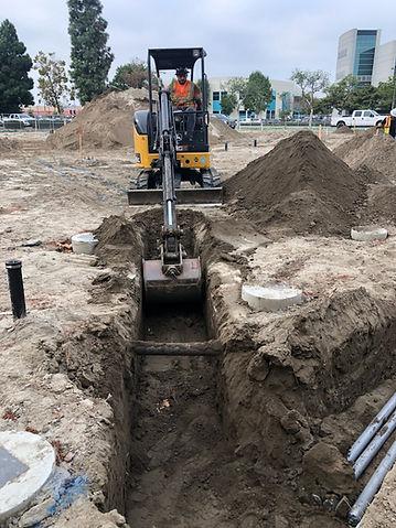 Compact Excavator Digging