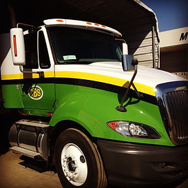 Chamberlain Backhoe Service Flatbed Truck