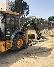 CBS Backhoe diging for electrical line