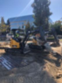 Mini Excavators digging